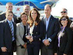 Will and Kate pose with Yellowknife Airport security staff before boarding a plane Wednesday. The couple is traveling to the U.S. with seven people.
