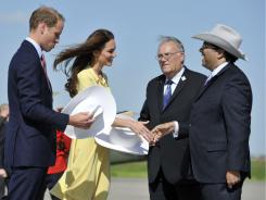 Britain's Prince William and his wife, Catherine, Duchess of Cambridge, are given white hats upon their arrival in Calgary, Alberta.