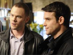 Steve Jinks (Aaron Ashmore), left,  joins Pete L attimer (Eddie McClintock) at Warehouse 13, a super-secret storage facility.