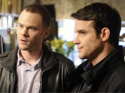 Steve Jinks (Aaron Ashmore), left,  joins Pete L attimer (Eddie McClintock) at Warehouse 13, a super-secret storage facility.