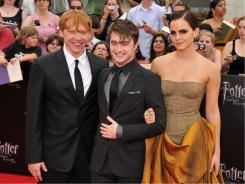 "Rupert Grint, left, Daniel Radcliffe and Emma Watson arrive at the New York premiere, ""I don't think we ever thought this day would come,"" Radcliffe said."