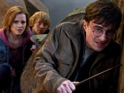 It's a fight to the finish:  Emma Watson, Rupert Grint and Daniel Radcliffe are in a battle of good vs. evil, love vs. hate.