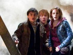 Harry Potter (Daniel Radcliffe, left), Ron (Rupert Grint) and Hermione (Emma Watson) face death and destruction in 'Deathly Hallows, Part 2.'