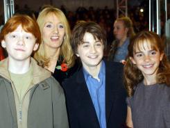 In 2001: Rupert Grint, left, Daniel Radcliffe and Emma Watson with author J.K. Rowling at the London premiere of 'Harry Potter and the Socerer's Stone.'