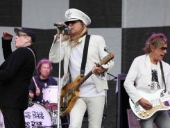 Cheap Trick, from left: Rick Nielsen, Bun E. Carlos, Robin Zander and Tom Petersson  perform at the Cisco Ottawa Bluesfest on Sunday.