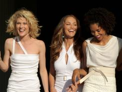New model Angels: Rachael Taylor, left, Minka Kelly and Annie Ilonzeh. Unlike the original series, their characters have flawed backgrounds.
