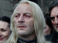 Jason Isaacs stars as warped wizard Lucius Malfoy, a prejudiced, haughty, long-blond-haired Death Eater.