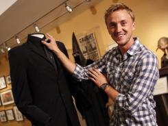 Potter Museum-goer and actor Tom Felton wore black on black as the white-haired, dark-hearted Draco Malfoy in the 'Potter' films.