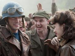 Rallying the troops:  Chris Evans and Hayley Atwell share a triumphant moment in  Captain America: The First Avenger .