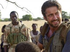 Gerard Butler stars as Sam Childers, a former criminal turned crusader for Sudanese orphans. Souleymane Sy Savane, back left, co-stars.