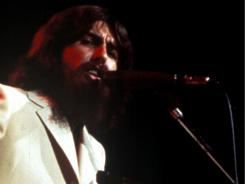 George Harrison performs during the 1971 Concert for Bangladesh. Among artists joining him: Ringo Starr, Bob Dylan and Leon Russell.
