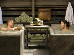 Maura Isles (Sasha Alexander), left,  and Jane Rizzoli (Angie Harmon) take time out from chasing criminals for a good soak.
