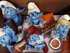 Oh my Smurf!  Clockwise from bottom left, Clumsy, Gutsy, Brainy, Smurfette and Papa, flee through a wormhole and land in NYC.