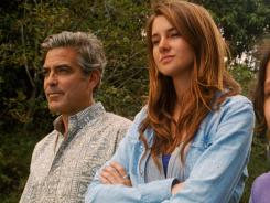 All in it together:  George Clooney and Shailene Woodley try to come to grips with big changes in their family in  The Descendants .