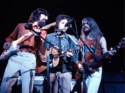 George Harrison, left, Bob Dylan and Leon Russell perform  during 1971's Concert for Bangladesh,  which will celebrate its 40th anniversary with a digital release on iTunes.