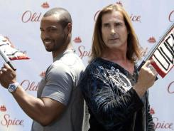American football player Isaiah Mustafa and Italian model Fabio attend a press event for Old Spice in Los Angeles on Thursday.
