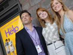Producer Brunson Green (from left) and actresses Emma Stone and Ahna O'Reilly pose as they arrive at the Malco Grandview Theater in Madison, Miss., on Saturday for the premier of 'The Help.'