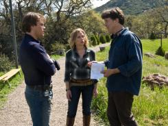 In his natural habitat:  Cameron Crowe, right, with stars Matt Damon and Scarlett Johansson on the set of  'We Bought a Zoo,' due Dec. 23.