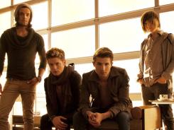 Members of the musical group Hot Chelle Rae: Ian Keaggy, left, Nash Overstreet, RK Follese and  Jamie Follese.