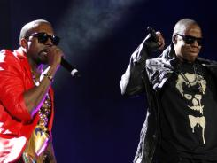 Downloadable duo:  Kanye West, left, and Jay-Z will release  Watch the Throne , their first full-album collaboration, on Monday exclusively on iTunes.