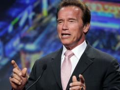 Arnold Schwarzenegger speaks after being honored by the Los Angeles Chamber of Commerce at the annual convention of the American Chamber of Commerce Executives (ACCE) on Thursday.
