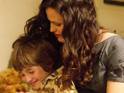 A mother's love:  Jennifer Garner hugs C.J. Adams in a scene from  Odd Life .
