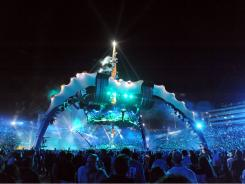 """Ready for retirement:  U2 performs in Pasadena, Calif., on an in-the-round stage nicknamed """"The Claw."""" After 110 concerts, three identical stages are up for sale."""