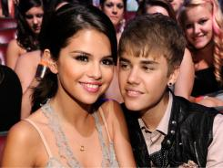 Selena Gomez and Justin Bieber share a moment at the  2011 Teen Choice Awards on Sunday.