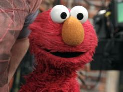 Elmo will be rubbing elbows with many celebrities this season on 'Sesame Street.'