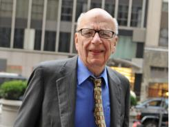 News Corporation head Rupert Murdoch enters the News Corp. building  in New York.