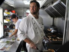 Mike Kennedy, left, Justin Hackett and chef Marc Melanson at work during the lunch rush on board Roxy's Gourmet Grilled Cheese.