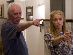 Pointing to a comeback:  John Carpenter directs Amber Heard on the set of  The Ward , his first feature film in 10 years.