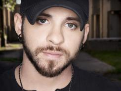 Turning point:  A serious car accident in 2004 led Brantley Gilbert to decide to pursue music full time. A deluxe  Halfway to Heaven  album is due Sept. 13.