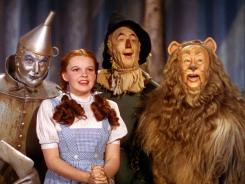 The 'Wizard of Oz' cast: Jack Haley as the Tin Woodman , leftm Judy Garland as Dorothy, Ray Bolger as the Scarecrow and Bert Lahr as the Cowardly Lion.