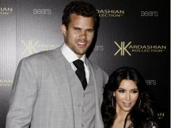 Kim Kardashian, right, and her fiance, NBA basketball player Kris Humphries, arrive at the Kardashian Kollection launch party in Los Angeles, on Aug. 17.  The couple wed on Aug. 20 in Montecito, Calif.