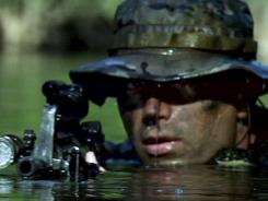 A Navy SEAL moves in during a personnel recovery mission in  'Act of Valor,' which is aiming for a February release.