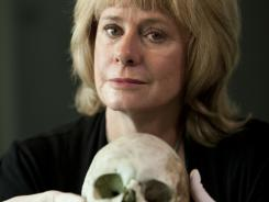 Skeletons can say a lot, says novelist and forensic anthroplogist Kathy Reichs, shown here in her laboratoire..