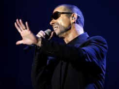 singer George Michael performs during his first Symphonica concert at the State Opera House in Prague, Czech Republic.