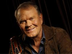 One last star-spangled rodeo:  Glen Campbell's final album,  Ghost on the Canvas, arrives in stores Tuesday.