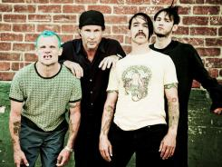 The Red Hot Chili Peppers are getting ready to release their new album. Flea, left, Chad Smith, Anthony Kiedes, Josh Klinghoffer.