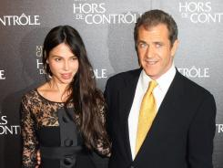 "Oksana Grigorieva and Mel Gibson arrive at the ""Edge Of Darkness""  premiere on Feb. 4, 2010, in Paris."