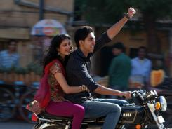 "Bad motor scooter:  Dev Patel takes Tena Desae for a ride around town in  The Best Exotic Marigold   Hotel . ""Oh, gosh, what a divine young man,"" says Patel's co-star Judi Dench."