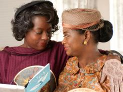 The Help, starring Viola Davis, left, and Octavia Spencer, was No. 1 at the box office for the second consecutive weekend.
