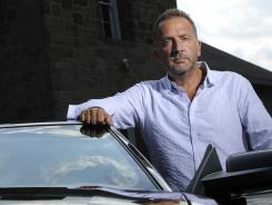 True grit:  George Pelecanos shows off his 2008 Mustang  Bullitt  Limited Edition car in the parking lot of Emory United Methodist Church in Washington where a scene from his new book,  The Cut , plays out.