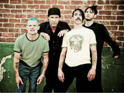 Red Hot Chili Peppers' new lineup includes Flea, left, Chad Smith, Anthony Kiedes and Josh Klinghoffer, who replaced John Frusciante.