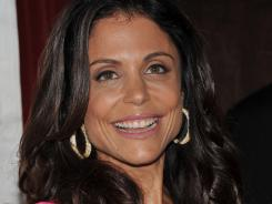 """Bethenny Frankel is a busy mom, too. She says daughter Bryn, 1, keeps her on her toes. """"She jumped into the dishwasher today."""""""