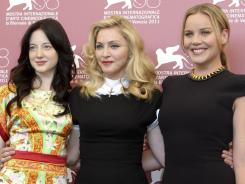actress Andrea Riseborough, left, US singer and director Madonna and Australian actress Abbie Cornish attend the premiere for the film 'W.E.' during the 68th edition of the Venice Film Festival.