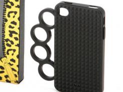 iPhone Clutch rubber with knuckles, $58, by Rebecca Minkoff. Available at Shopbop.com at Christmas.