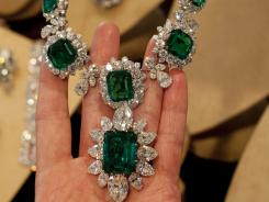 Taylor's emerald and diamond necklace and pendant, a gift of Richard Burton, will be auctioned off in New York on Dec. 13-14.