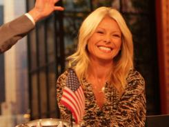 Kelly Ripa says she'd love to work with Anderson Cooper, but he'll be busy with his own talk show this fall.